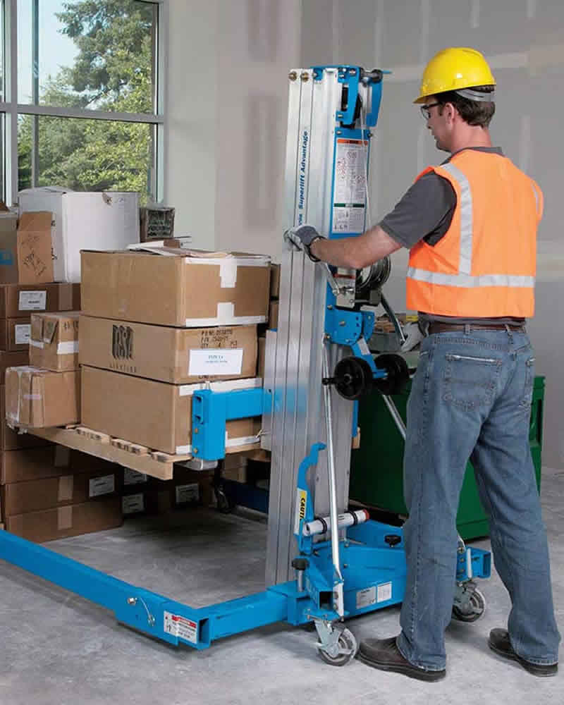 Worker with extended base Genie SLA lifting packing cases