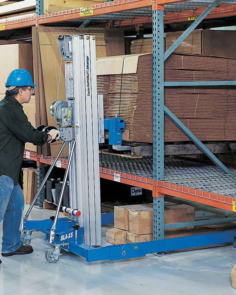 Worker with Genie stacking warehouse shelves