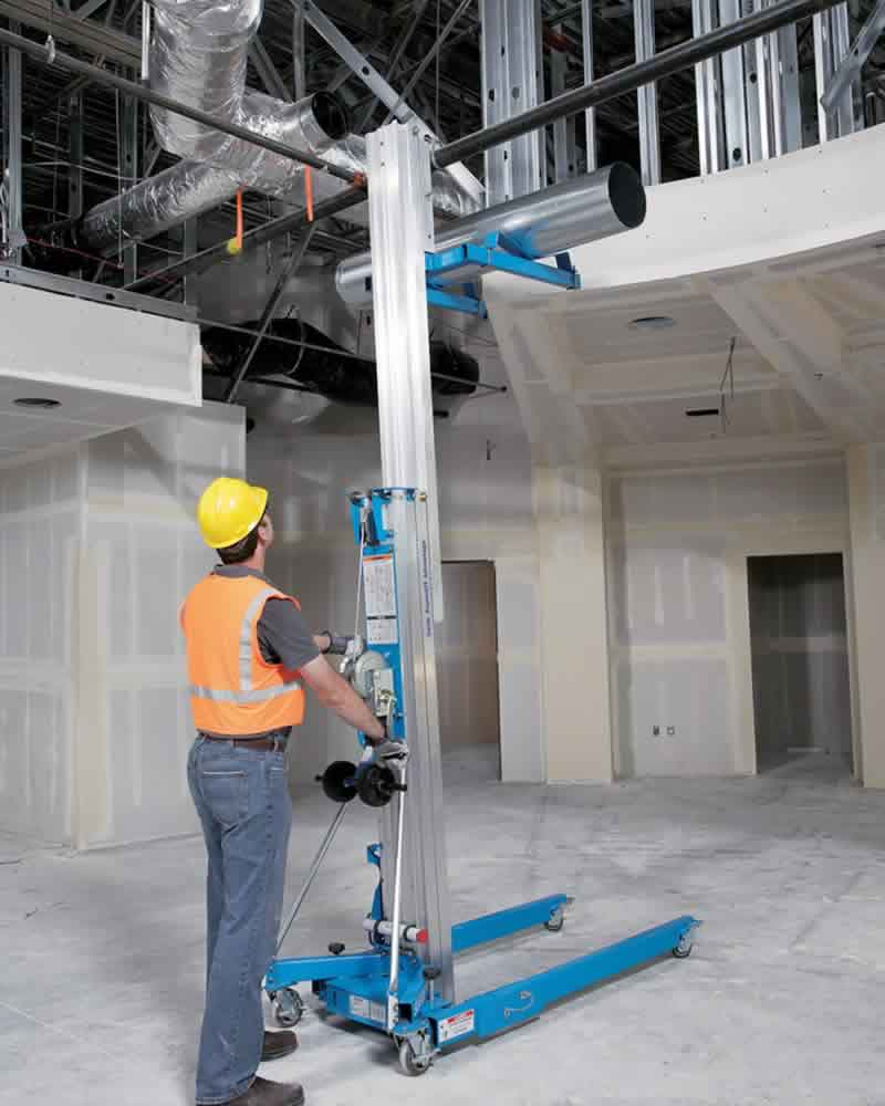 Genie SLA lifting pipework at height