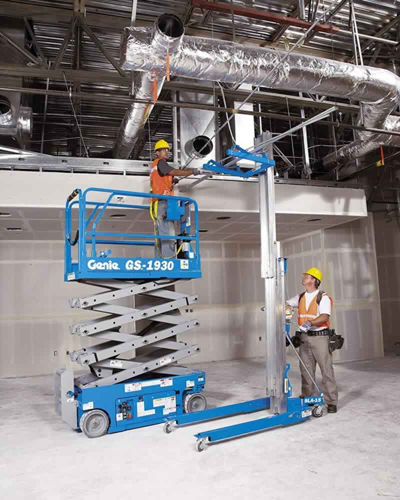 Genie SLA and Genie Scissor lift installing pipework at height